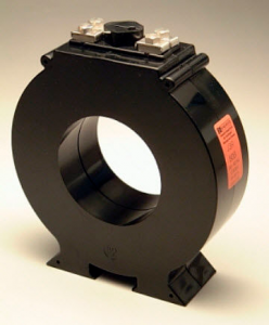A typical current transformer. A conductor is passed through the hole, and an output is provided for indirect current measurement by an instrument.